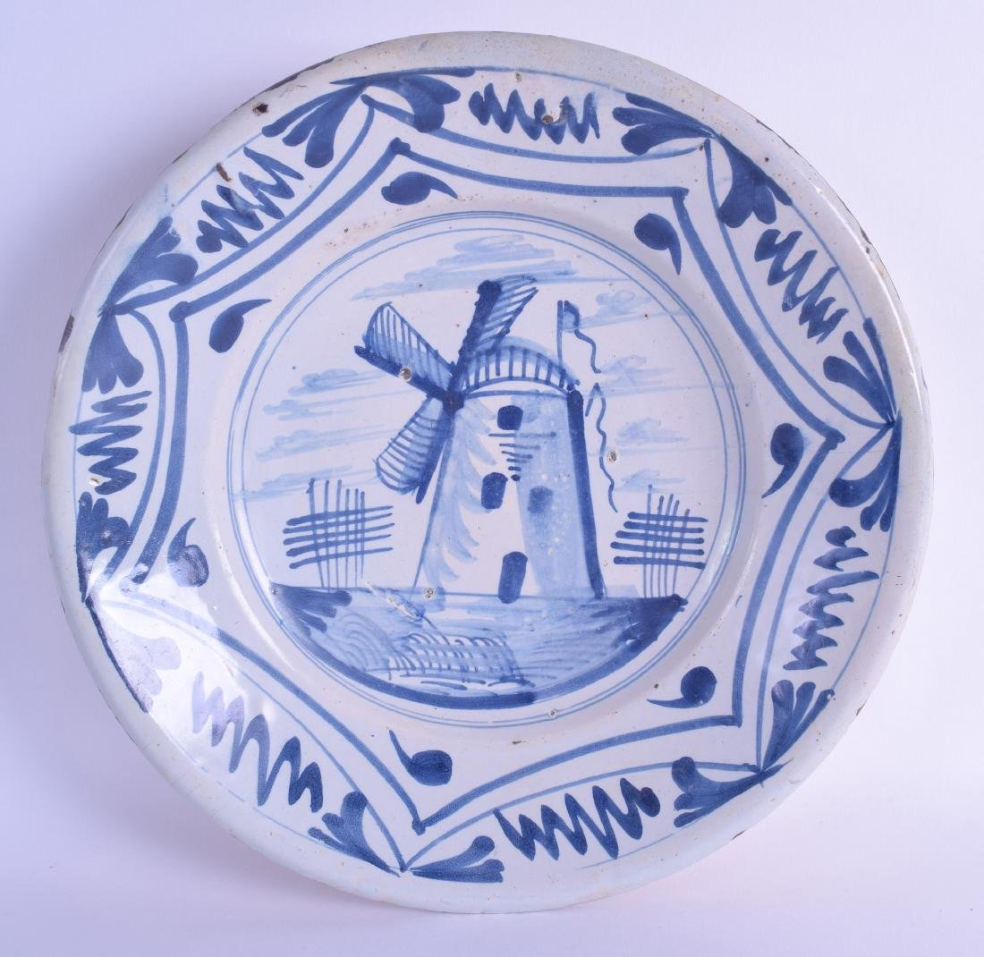 A 17TH CENTURY EUROPEAN BLUE AND WHITE DELFT FAIENCE