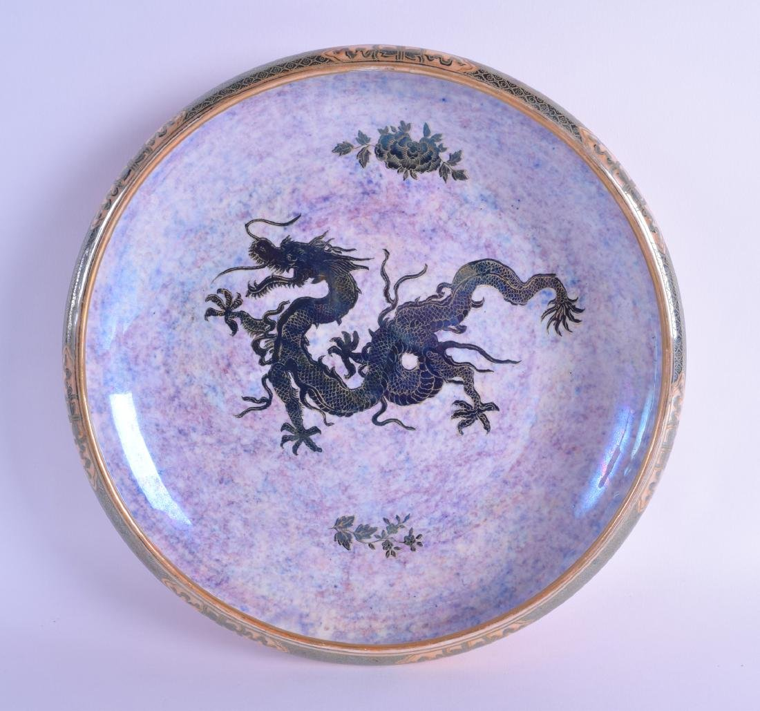 A LAWLEYS ORANGE LUSTRE SHALLOW BOWL decorated with a
