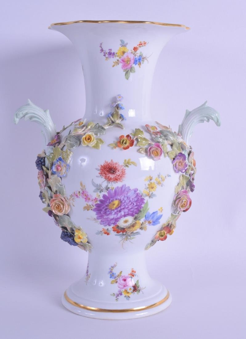 A TWIN HANDLED MEISSEN PORCELAIN VASE painted with