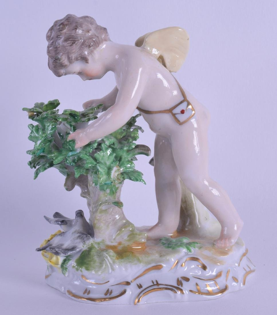 A DRESDEN PORCELAIN FIGURE OF A PUTTI modelled beside