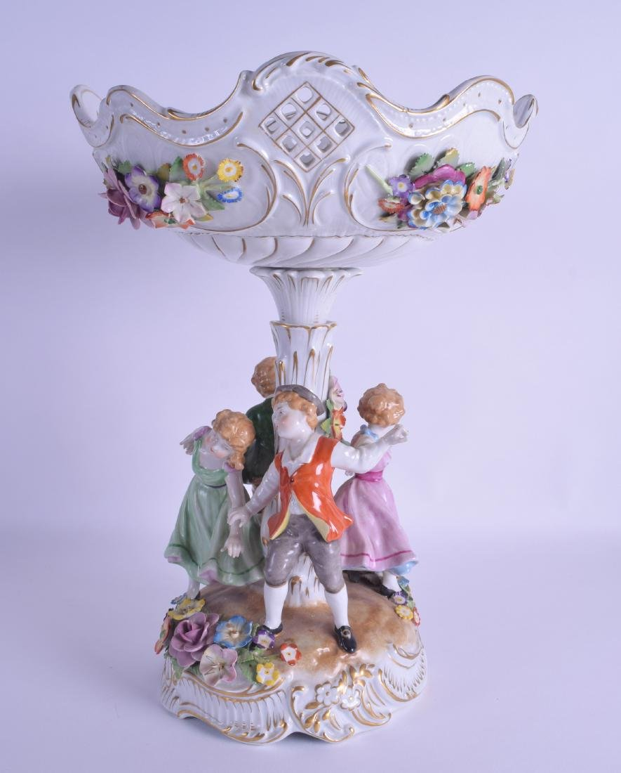 A 1950S GERMAN PORCELAIN TABLE CENTREPIECE modelled as
