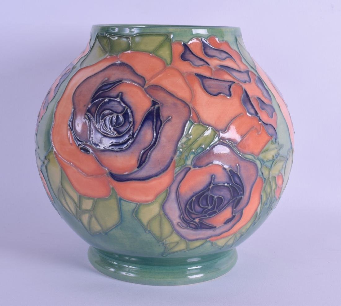 A WALTER MOORCROFT GREEN GROUND BULBOUS VASE painted