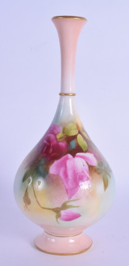 A ROYAL WORCESTER PORCELAIN VASE painted with flowers