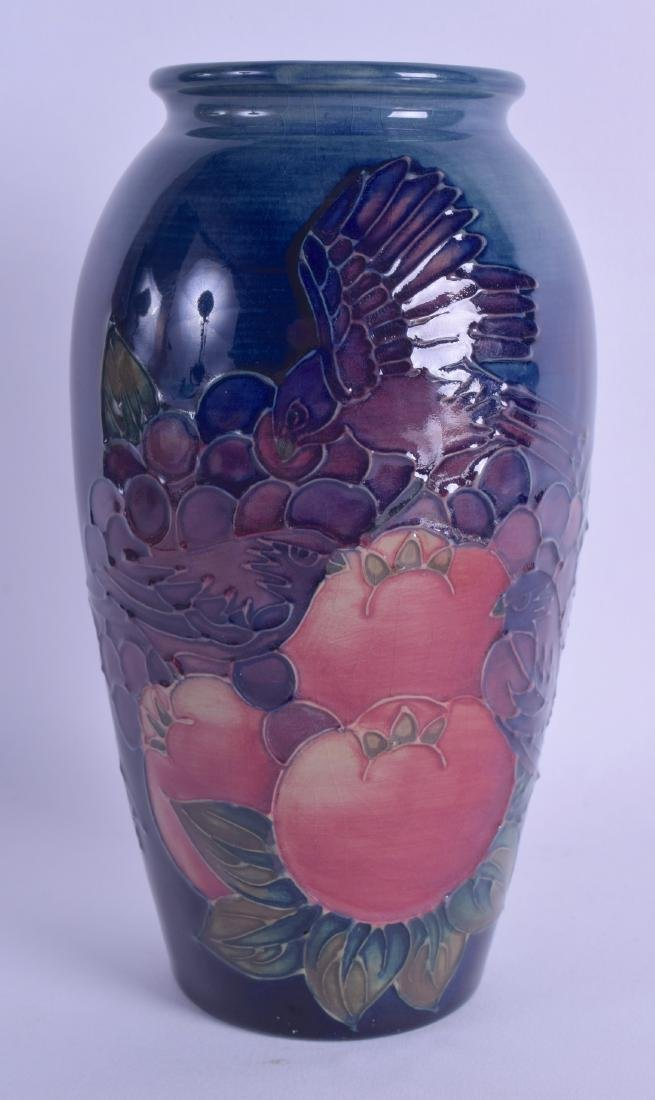 A WALTER MOORCROFT VASE decorated with a bird perched