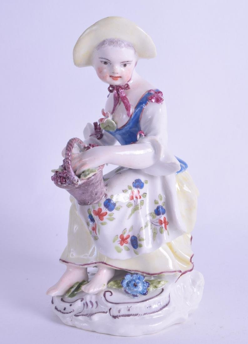 18th c. Bow figure of a girl seated with a basket of