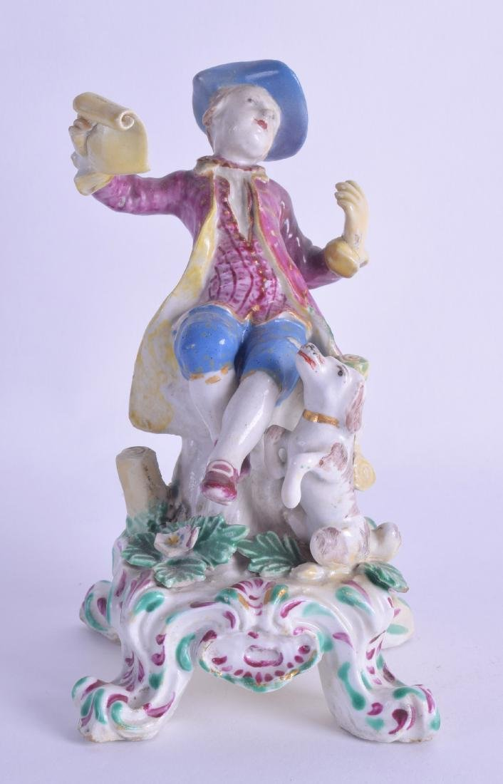 18th c. Bow figure of a boy seated with a sheet of