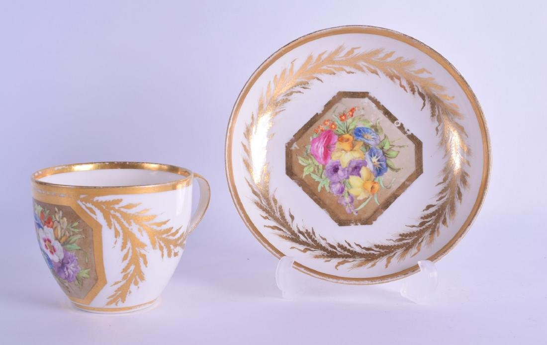 18th c. Derby tea cup and saucer painted with a lavish