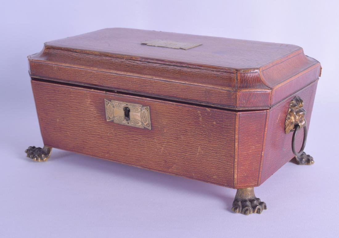 AN UNUSUAL EARLY 19TH CENTURY LEATHER SEWING CASKET the