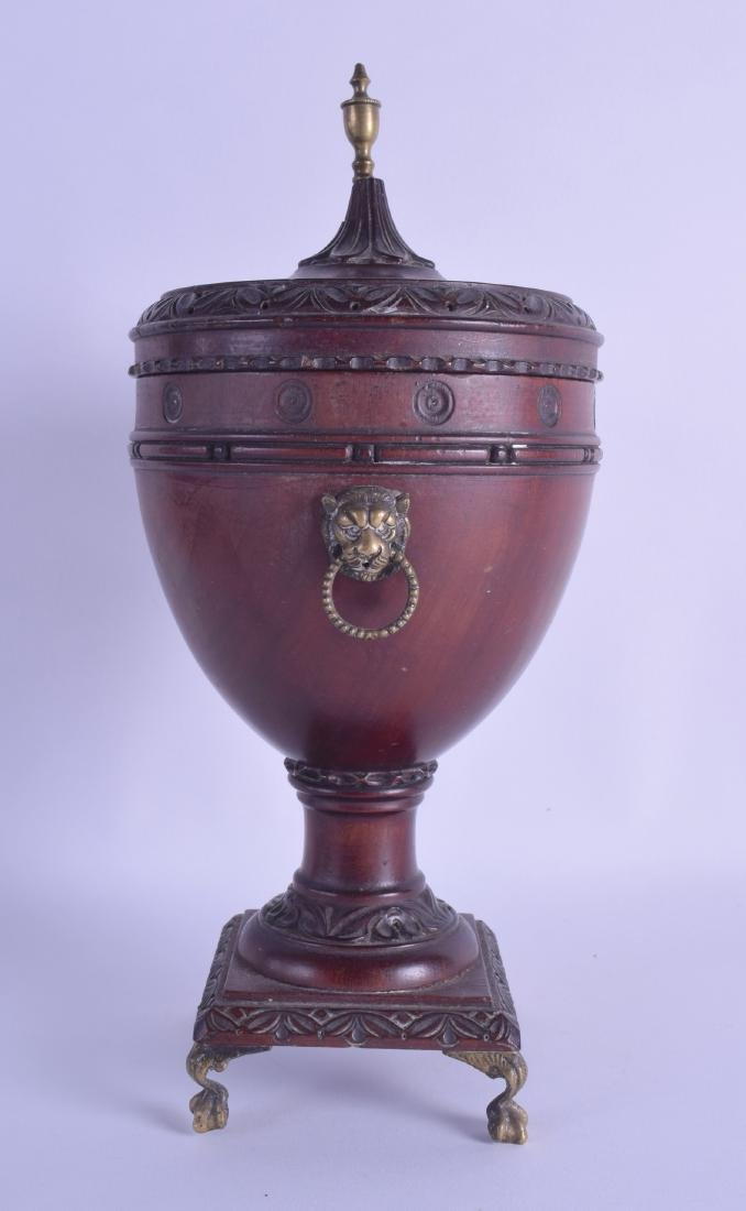 A LATE 19TH CENTURY CONTINENTAL CARVED WOODEN URN AND