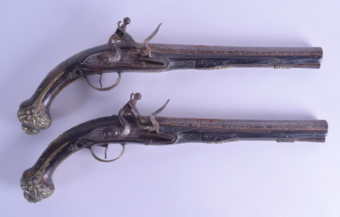 A PAIR OF 19TH CENTURY CONTINENTAL SILVER INLAID
