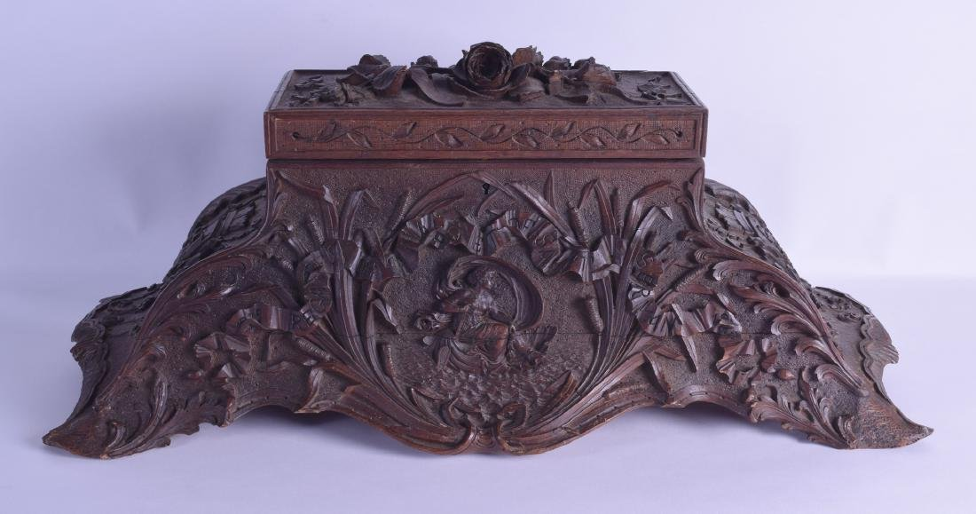 A VERY LARGE 19TH CENTURY BAVARIAN BLACK FOREST CASKET