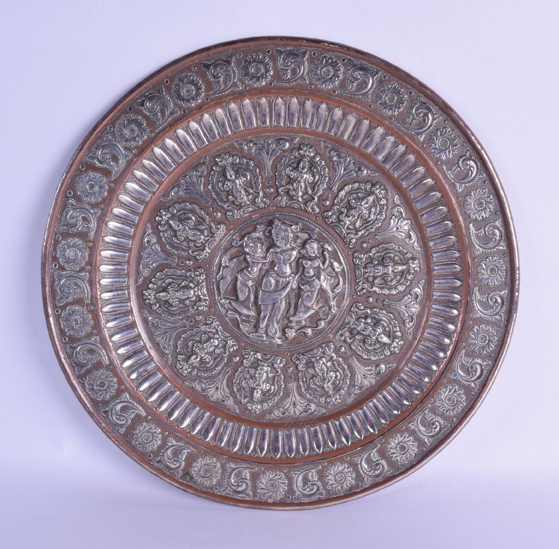 A 19TH CENTURY INDIAN SILVER INLAID COPPER DISH