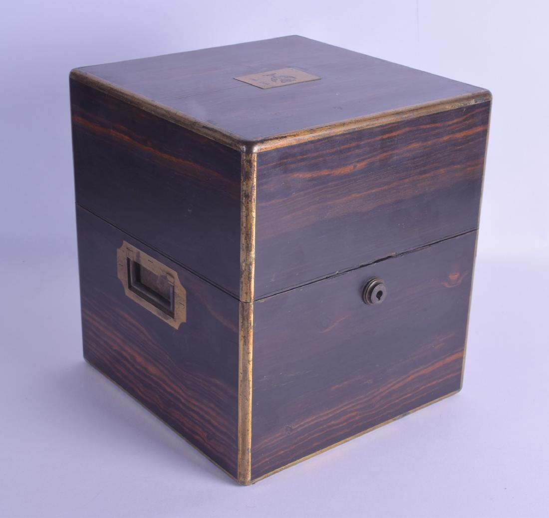 A MID VICTORIAN COROMANDEL DECANTER BOX AND COVER