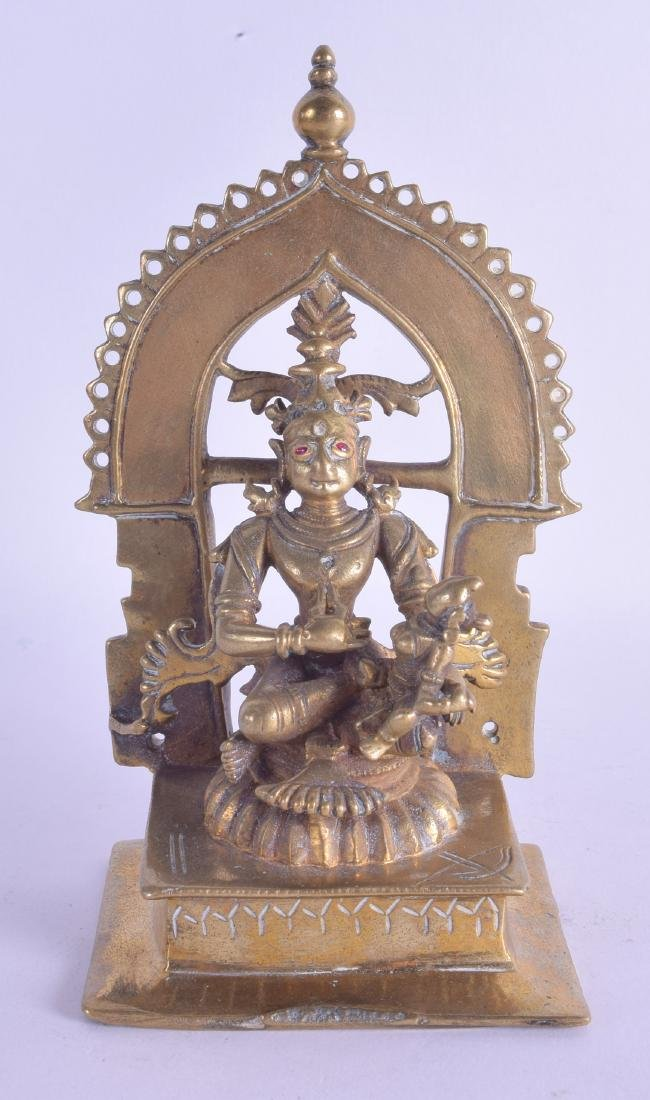A 17TH/18TH CENTURY INDIAN BRONZE FIGURE OF A