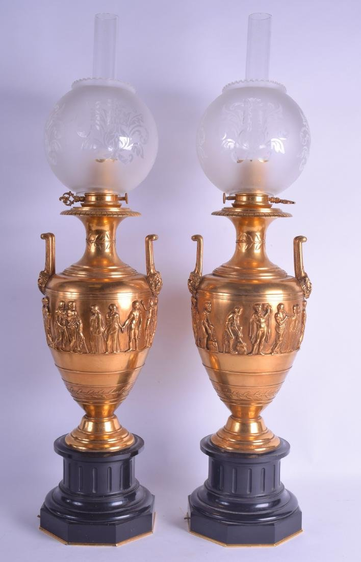 A FINE LARGE PAIR OF 19TH CENTURY ORMOLU TWIN HANDLED