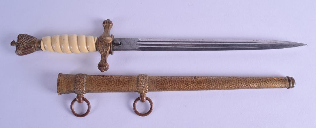 A MILITARY NAZI NAVAL DAGGER with hammered scabbard and