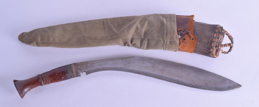 A WWII INDIAN ARMY KUKRI with leather scabbard. 50 cm