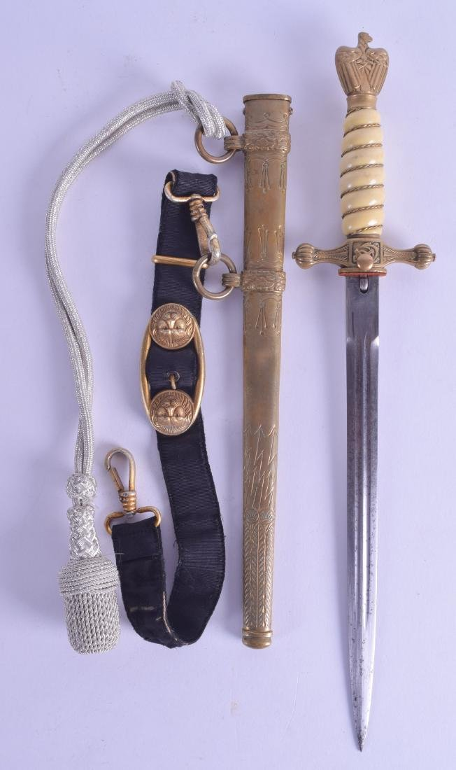 A WWII NAZI NAVY DAGGER with strap. 40 cm long.