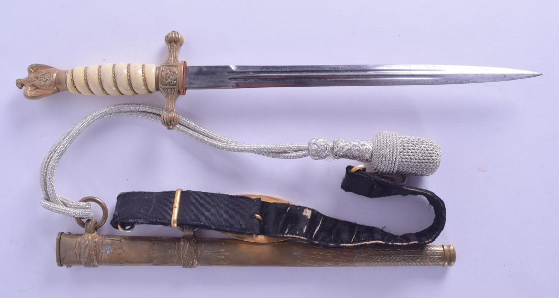 A WWII NAZI NAVY DAGGER with strap. 40 cm long. - 2