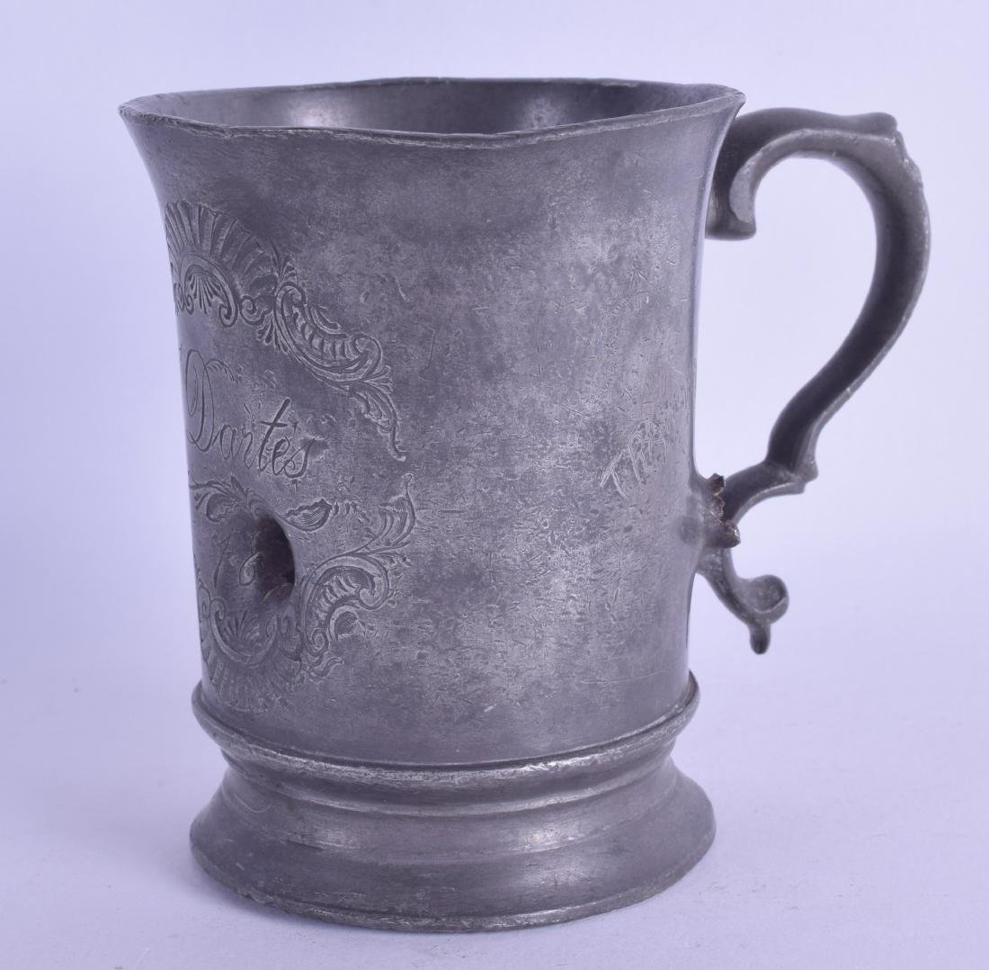A 19TH CENTURY CONTINENTAL PEWTER MUG with bullet hole,