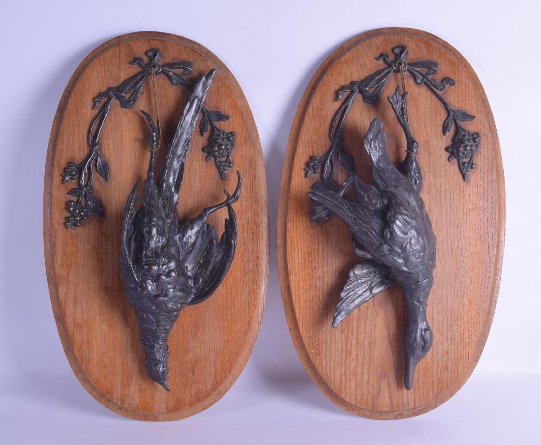 A GOOD PAIR OF 19TH CENTURY FRENCH BRONZE WALL PLAQUES