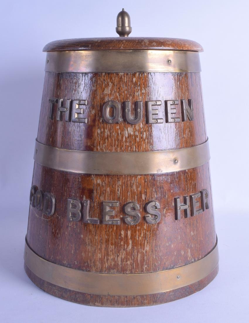A BRITISH NAVAL OAK BRASS BOUND RUM BARREL with applied