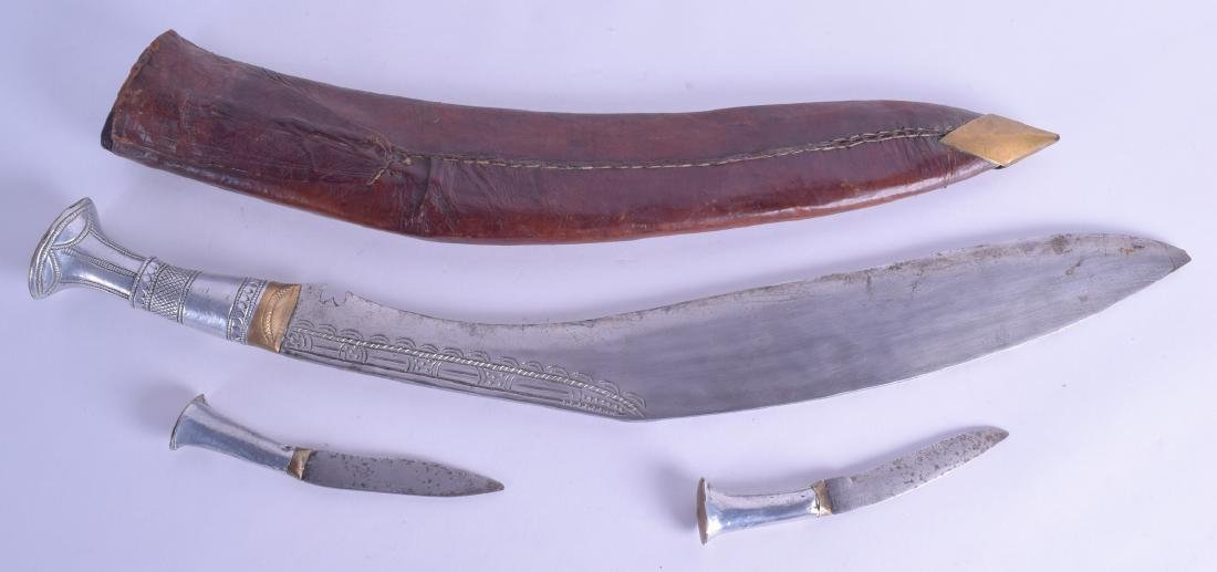 A 1920S INDIAN SILVER HANDLED KUKRI with leather