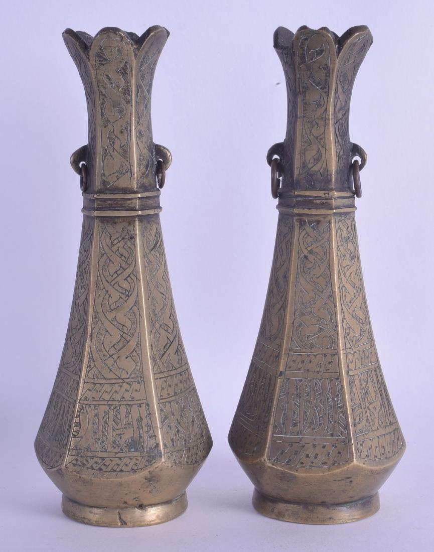 A PAIR OF 19TH CENTURY MIDDLE EASTERN BRASS VASES