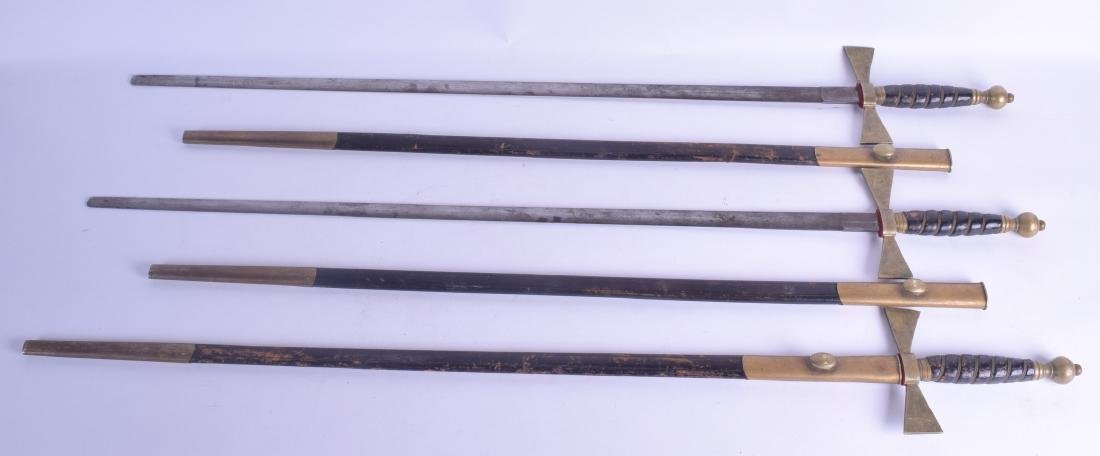 A SET OF THREE ANTIQUE BRASS HANDLED SWORDS with cross