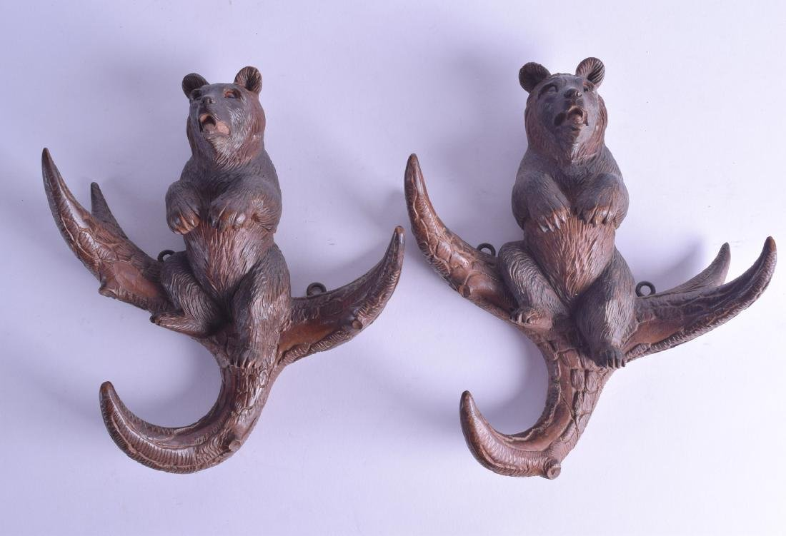 A PAIR OF LATE 19TH CENTURY BAVARIAN BLACK FOREST WALL