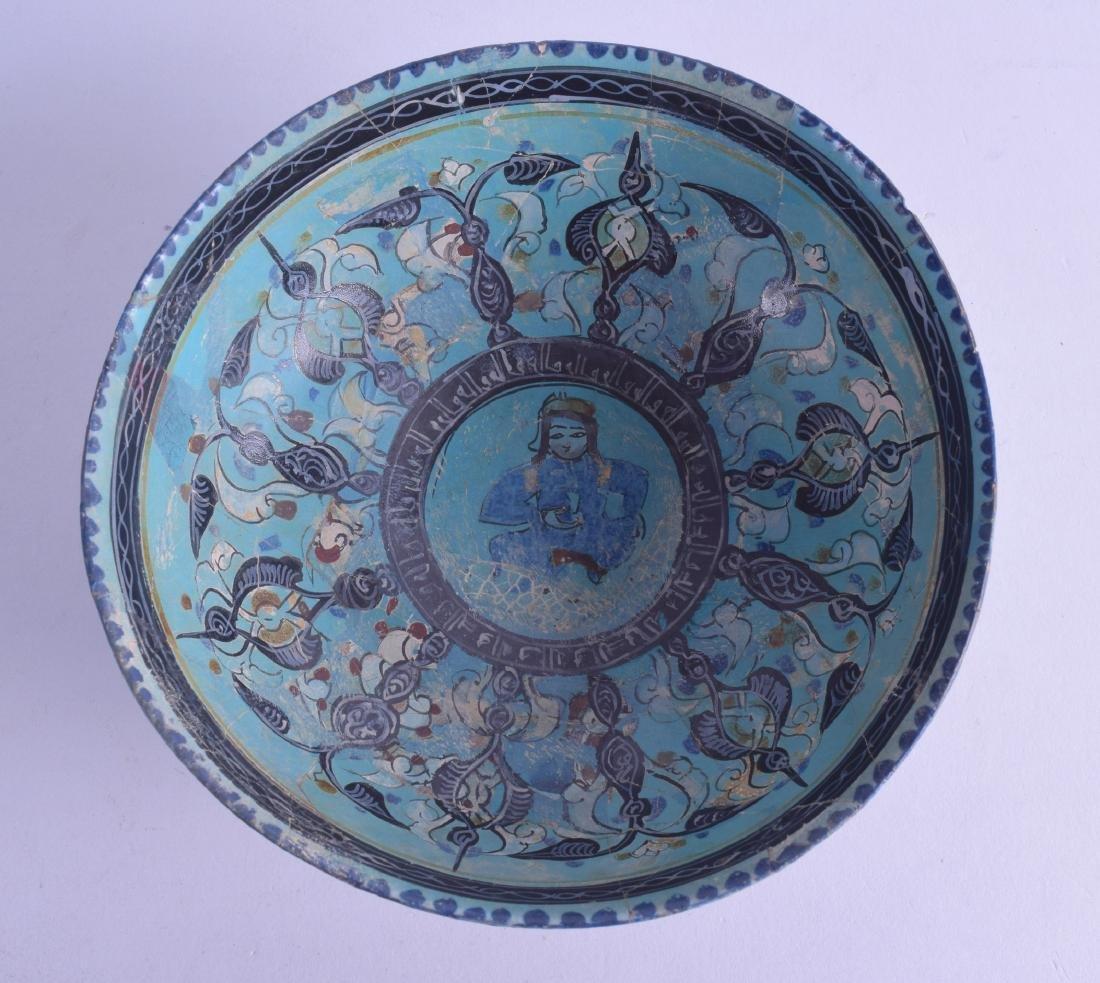 A RARE 13TH CENTURY KASHAN MINAI BOWL depicting