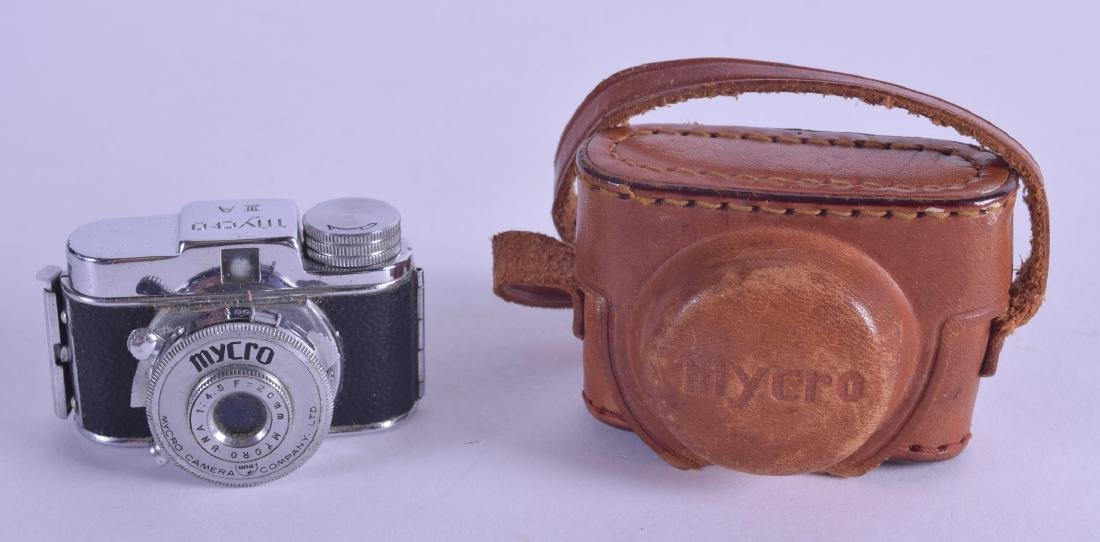 A RARE MYCRO SPY CAMERA within original leather case.