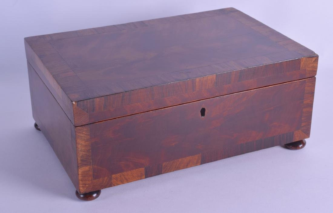 A MID VICTORIAN ROSEWOOD STATIONARY CASKET of