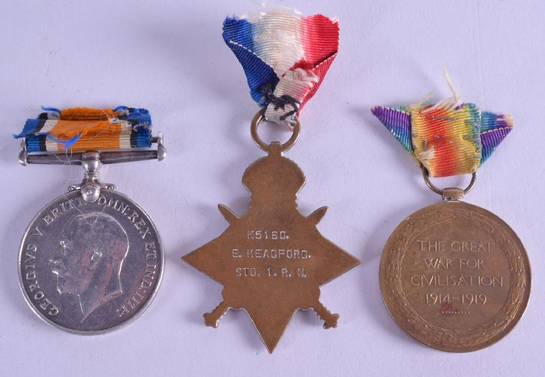 A SET OF THREE WWI MEDALS presented to K1560 F Headford - 2