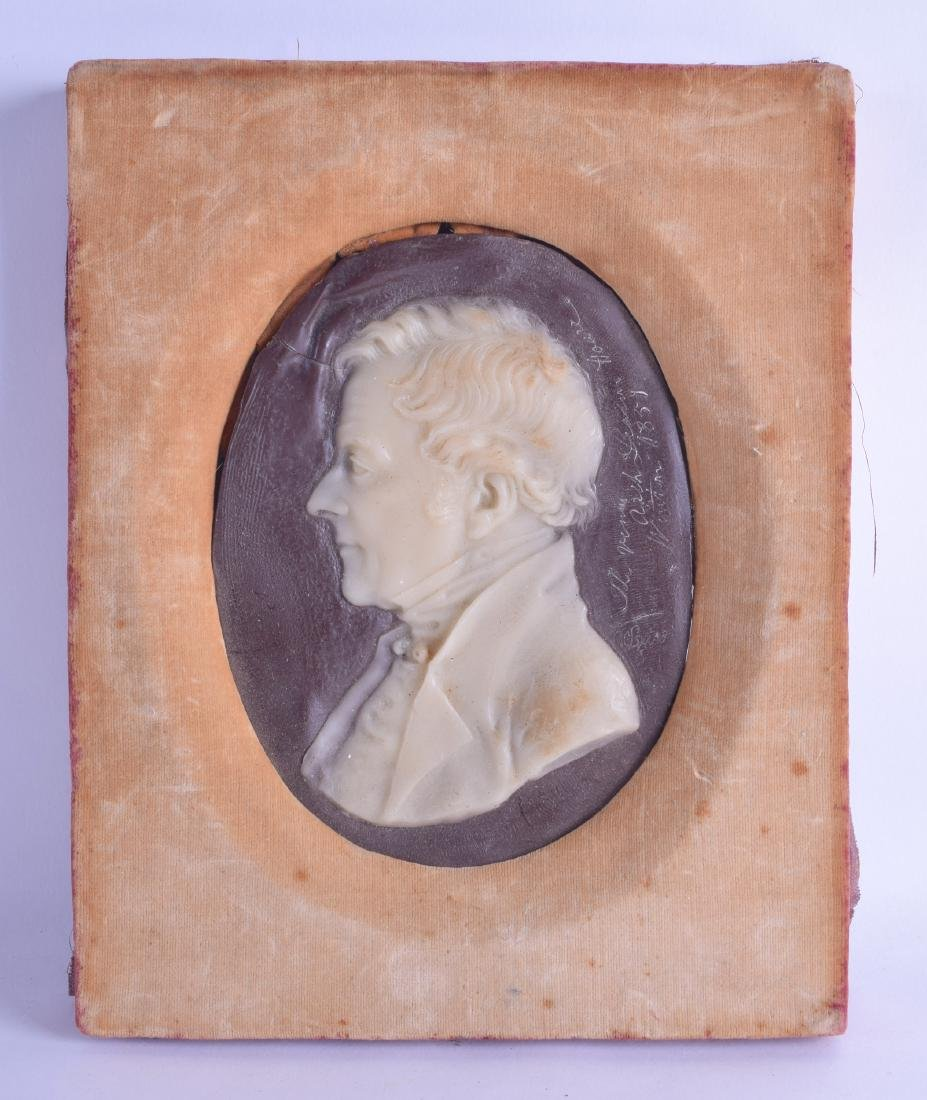 A MID 19TH CENTURY FRAMED WAX PORTRAIT OF A MALE within