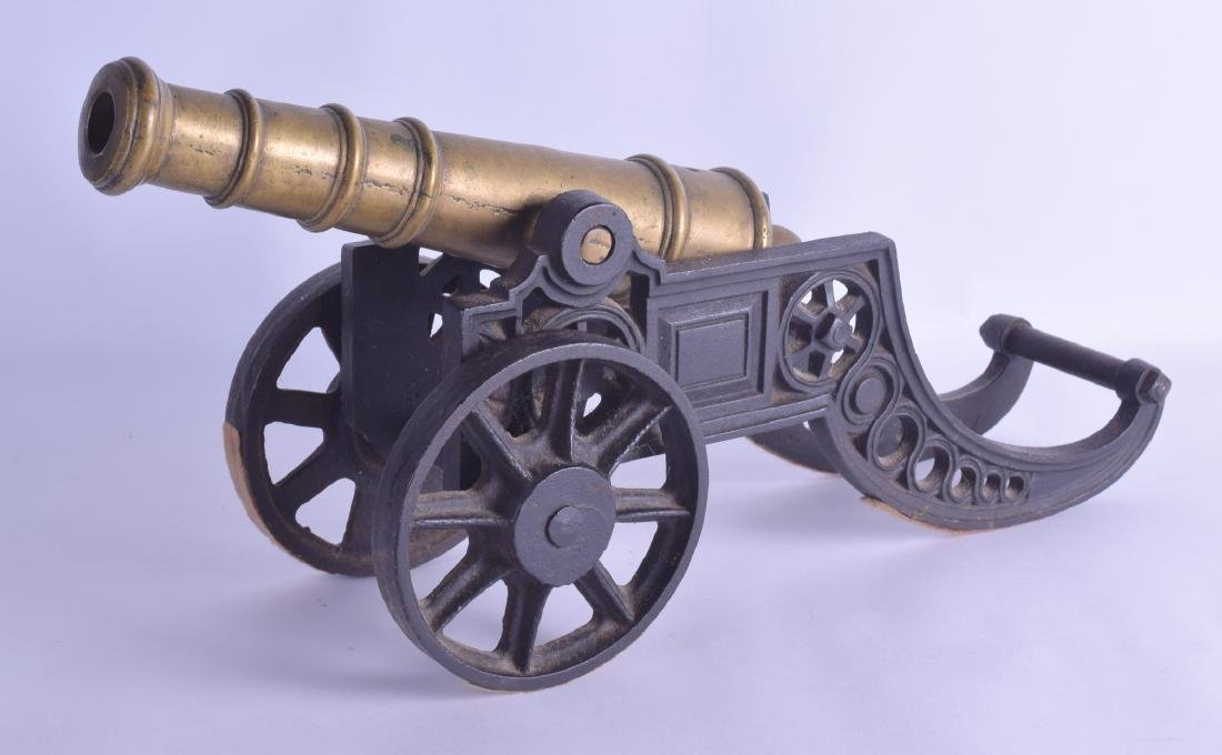 A LATE VICTORIAN BRASS AND CAST IRON SIGNAL CANNON. 42