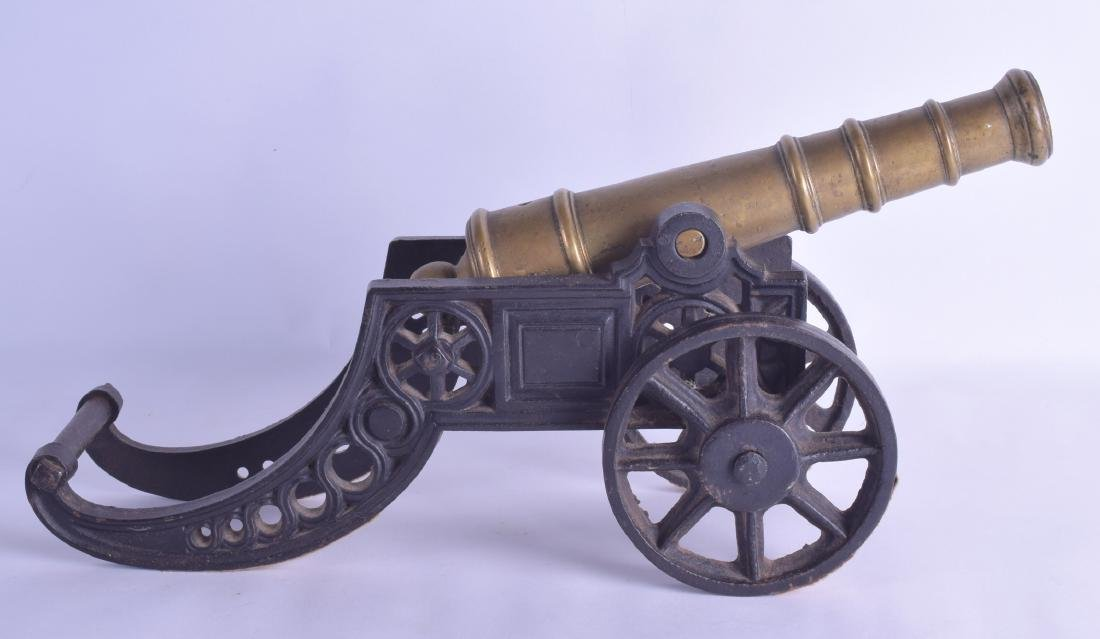 A LATE VICTORIAN BRASS AND CAST IRON SIGNAL CANNON. 42 - 2