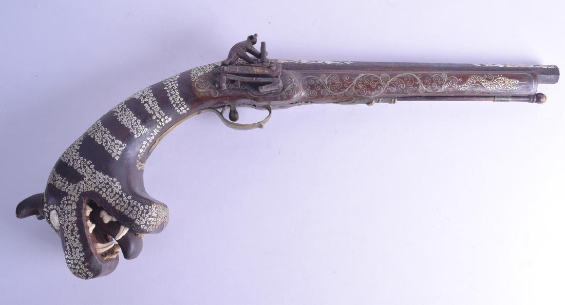A GOOD LARGE 19TH CENTURY AFRICAN CARVED WOODEN PISTOL