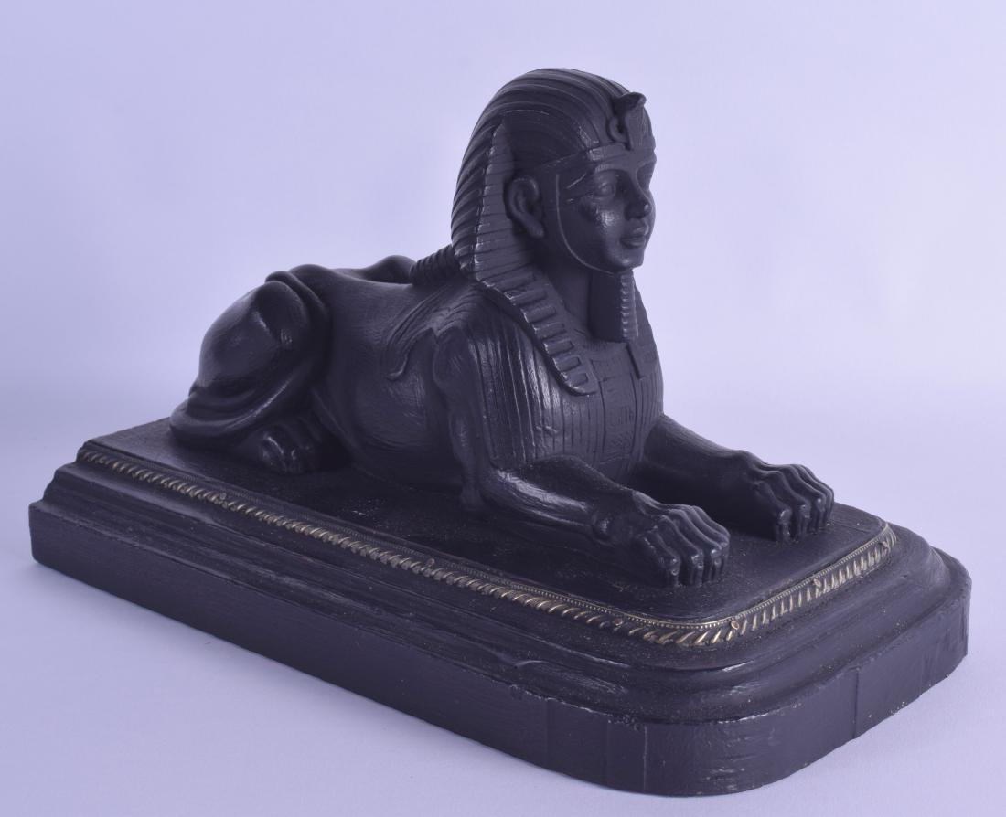 AN EGYPTIAN GRAND TOUR STYLE FIGURE OF A SPHINX