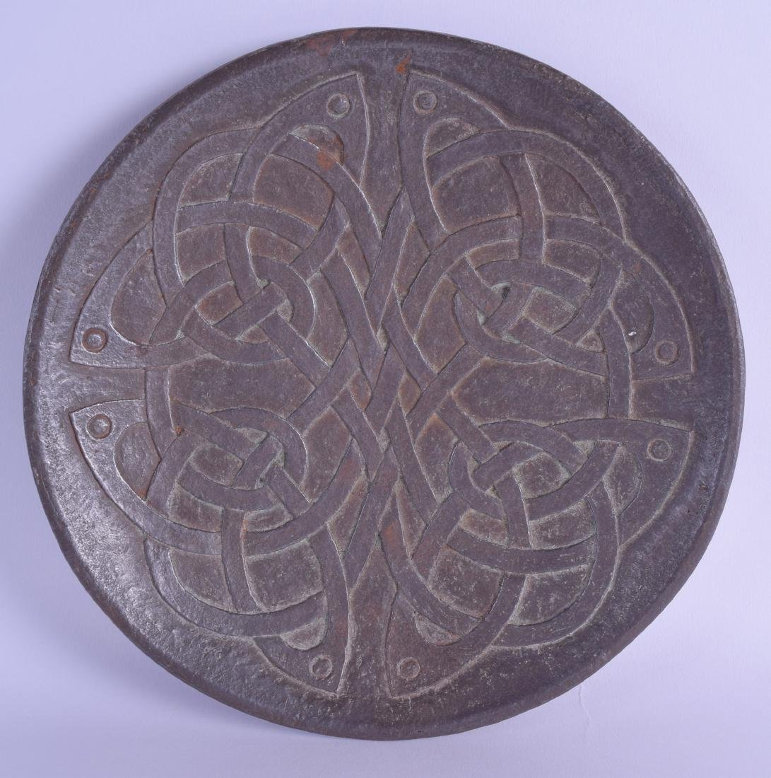 AN UNUSUAL ARTS AND CRAFTS CELTIC STYLE IRON DISH