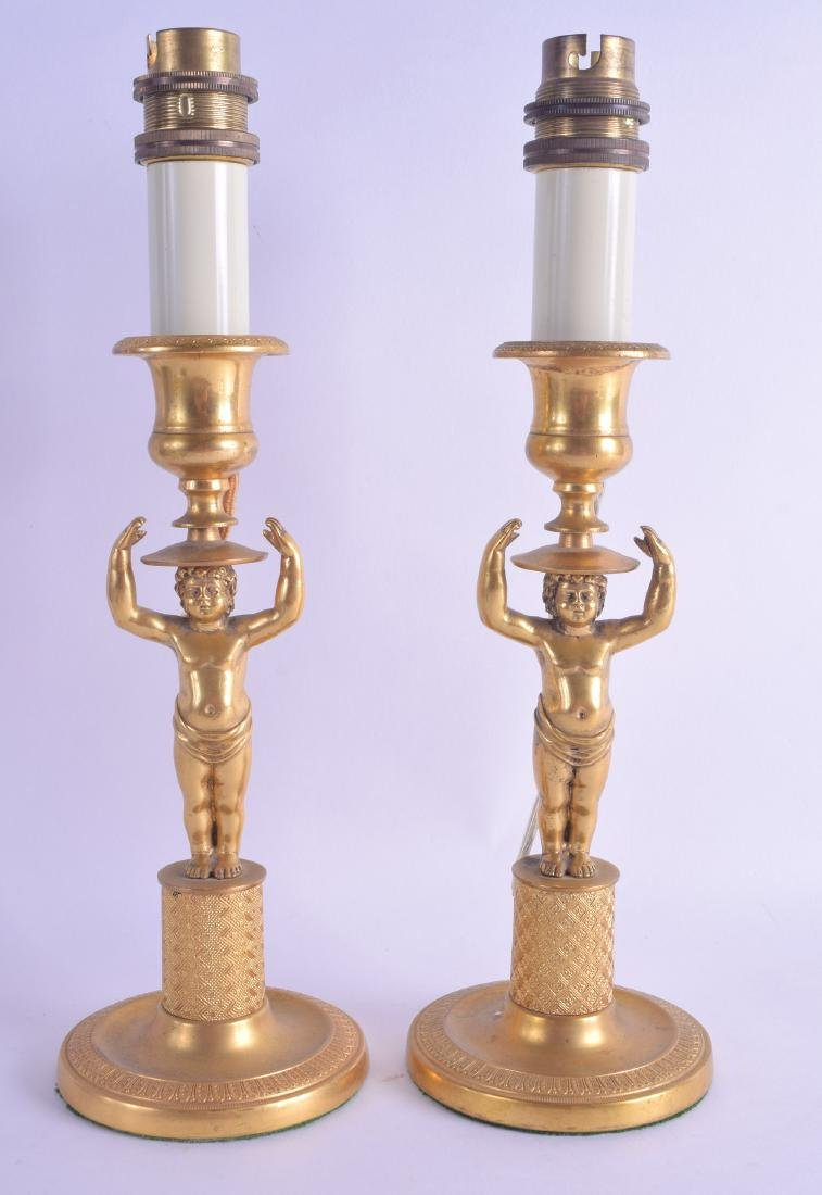 A PAIR OF EARLY 19TH CENTURY FRENCH ORMOLU CANDLESTICKS
