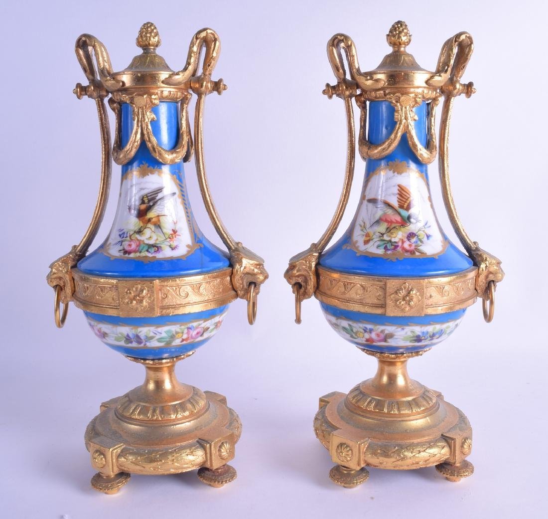 A PAIR OF 19TH CENTURY SEVRES PORCELAIN VASE AND COVER