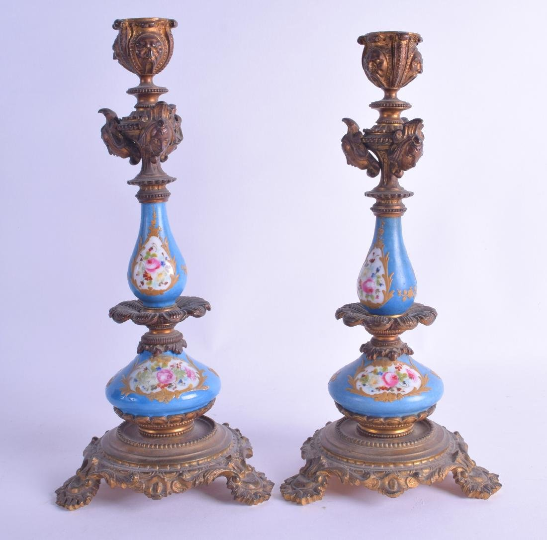 A PAIR OF 19TH CENTURY SEVRES PORCELAIN CANDLESTICKS