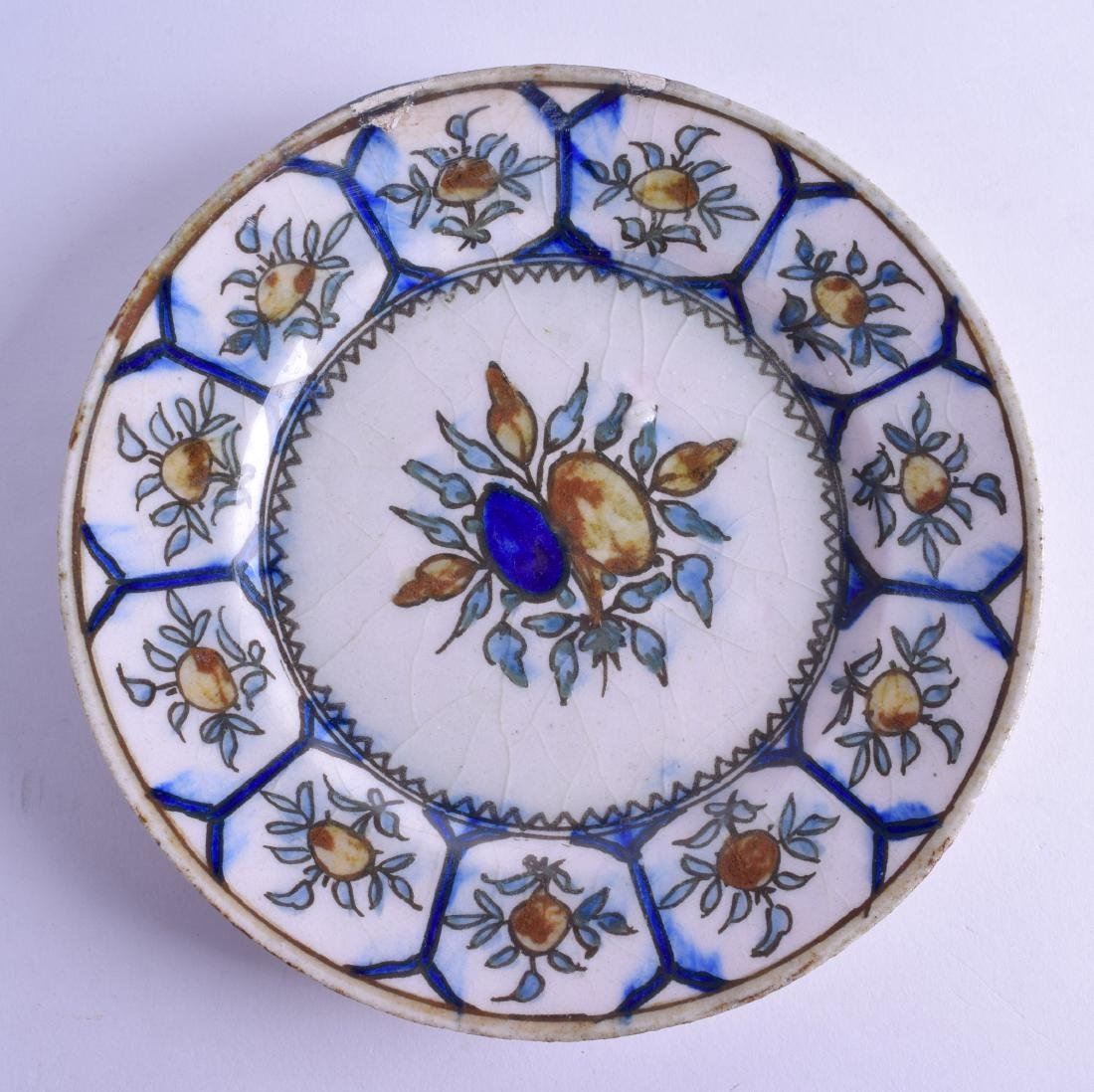 A 19TH/20TH CENTURY PERSIAN QAJAR POTTERY DISH painted