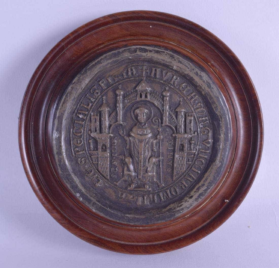 A 19TH CENTURY MAHOGANY CASED WAX SEAL depicting a