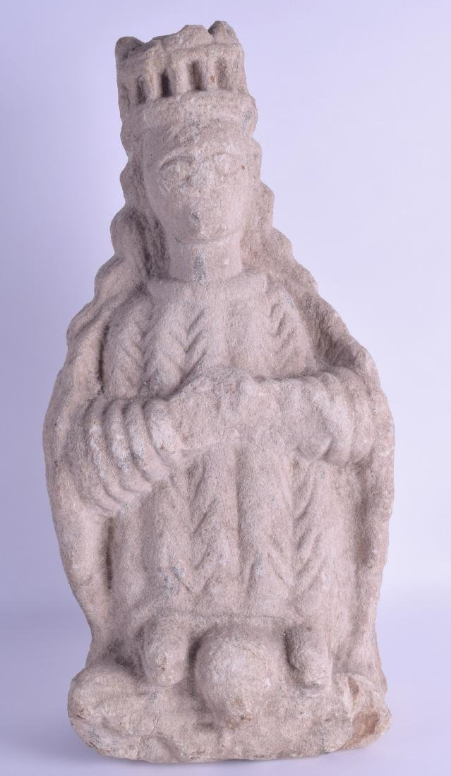 A GOOD EARLY MEDIEVAL CARVED STONE FIGURE OF A SAINT