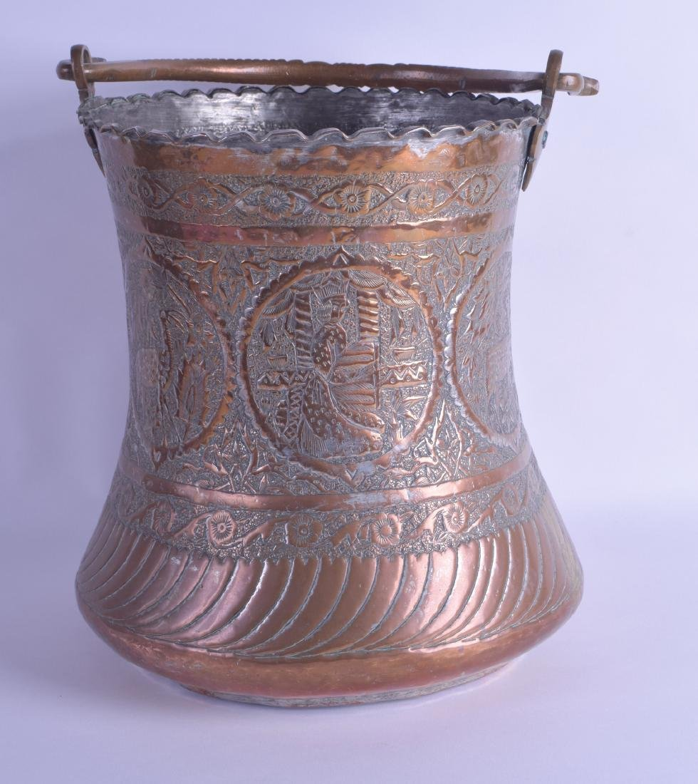 A LARGE 19TH CENTURY MIDDLE EASTERN COPPER BUCKET