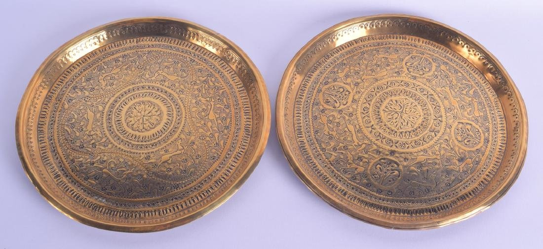 A PAIR OF 19TH CENTURY INDIAN ENGRAVED BRASS DISHES