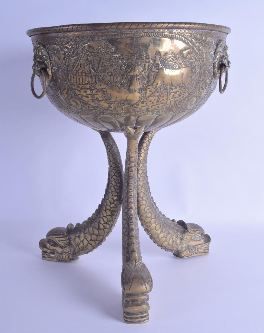 A LARGE MID 19TH CENTURY DUTCH CRESTED BRASS BOWL
