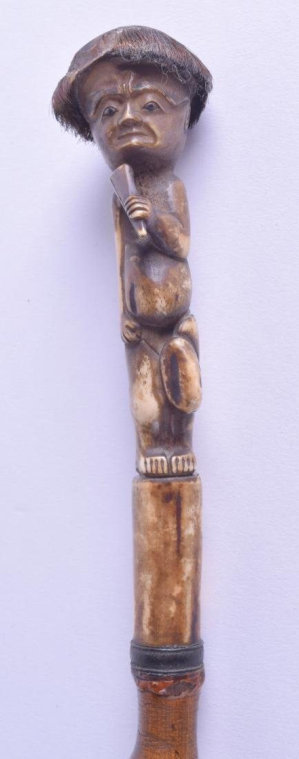 A RARE 19TH CENTURY CARVED BONE WALKING CANE the finial